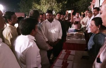 Administrative Officers Inspecting the stall at Night Camp