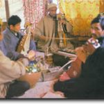 Playing Rabab and Saran