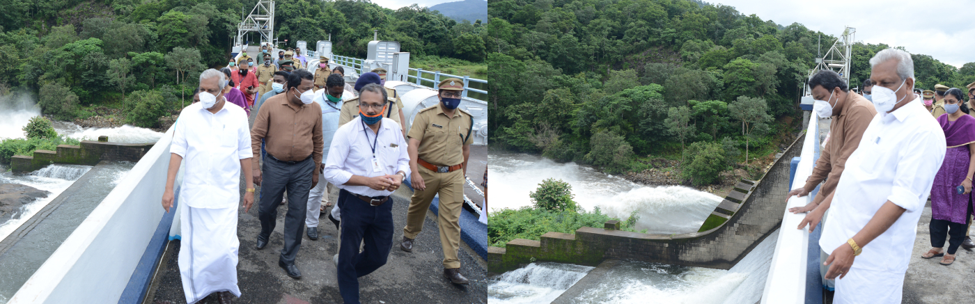 After the opening of the sluice gate of the Peringalkuthu Dam, Honorable Minister AC Moideen & District Collector S Shanawas monitoring the flow of water - 2020