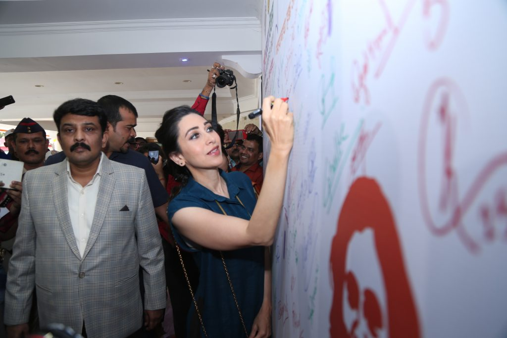 Karishma Kapoor Signing on sign board