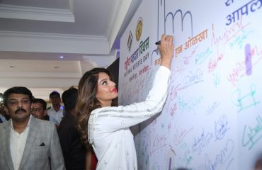 Bipasha Basu Signing on sign board