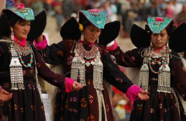 Ladakhi women in traditional dress performing folk dance