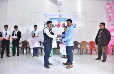 Krishna Kumar,IAS ACto DC giving Prize to Students