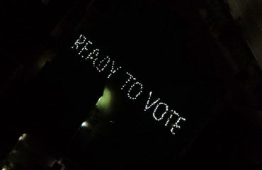 Students of tribal hostels & Kamla college wrote ready to vote and 12 nov for voter awareness