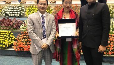 Woman Awardee, DC and SDO Ukhrul after receiving the award