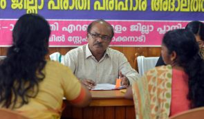 SC/ST commission chairman B S Mavoji examining the complaints at a sitting at Collectorate