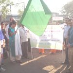 District Election Officer Showing Green Flag to Rally