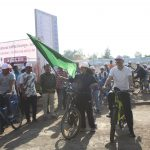 District Election Officer showing green Flag to Bicycle Rally