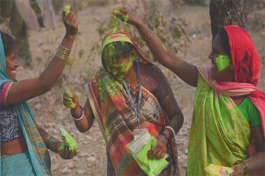 women playing holi