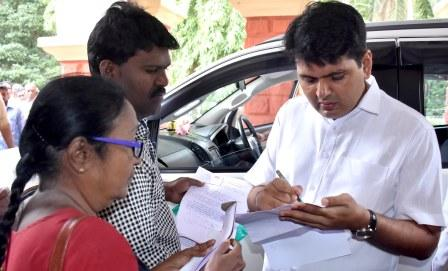 District Collector receiving petitions and applications at collectorate