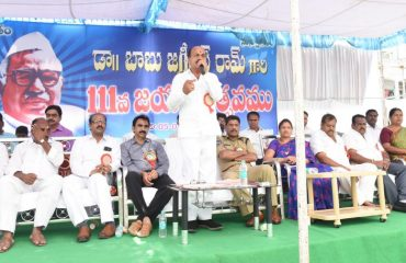 MLA addressing the gathering pepole in Program