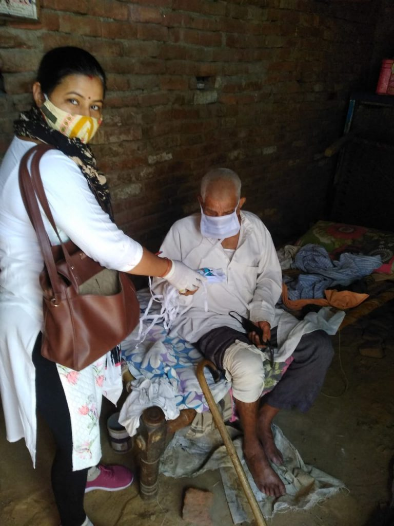 Free distribution of masks and sanitizers to people by the officials and BLOs of AC 36, Bijwasan1