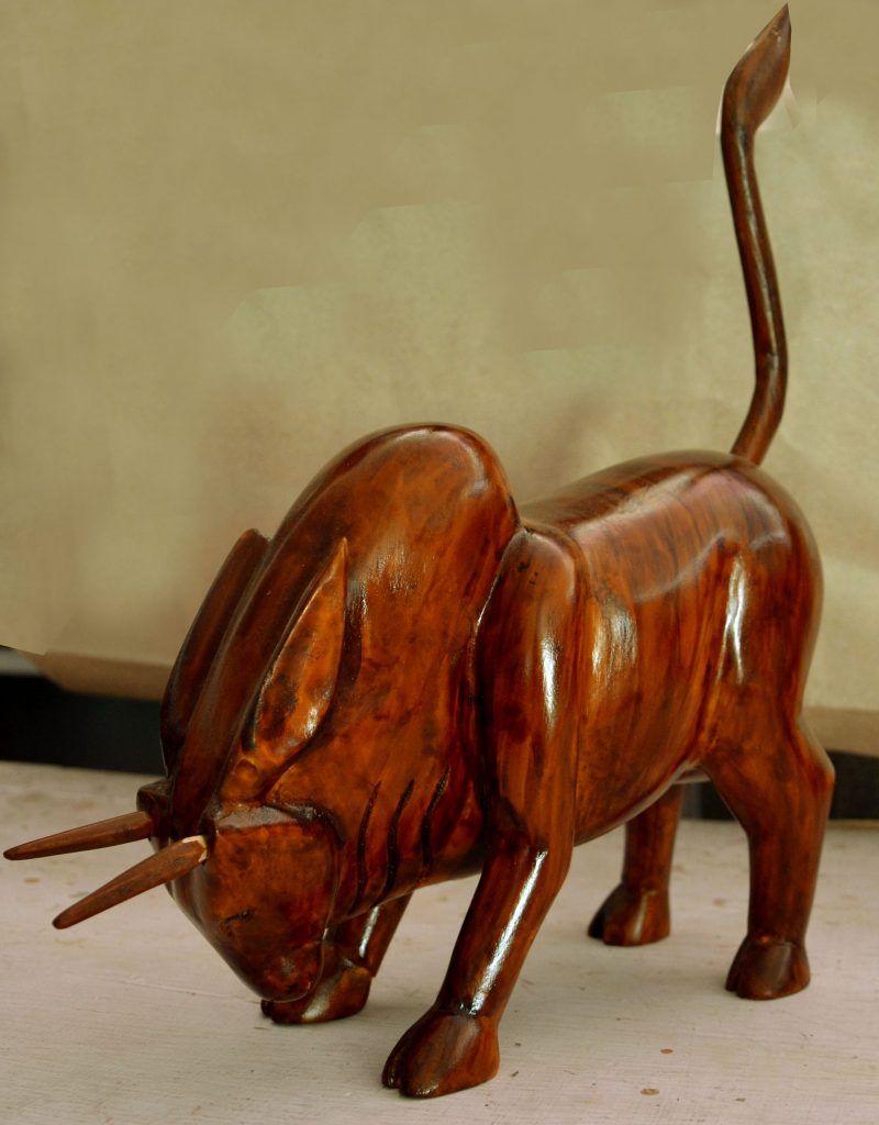 Wood carving of a bull