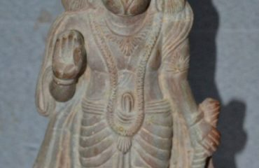 Stone carving of god