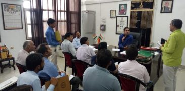 Sub-district election officer and city-general Rohit Yadav taking a meeting of political parties and officials