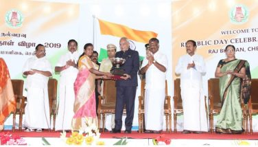 District Collector receiving Flag Day Collections 2nd Prize Cup from Hon'ble Governor