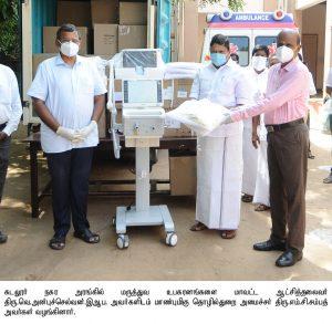 Minister giving Medical Weqipments