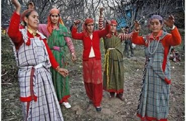 Woman Dancing in Tradional Dress in a Village