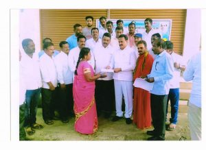 distributing financial assistance check for the first crop in Lachhapeta Village, Machareddy Mandal.