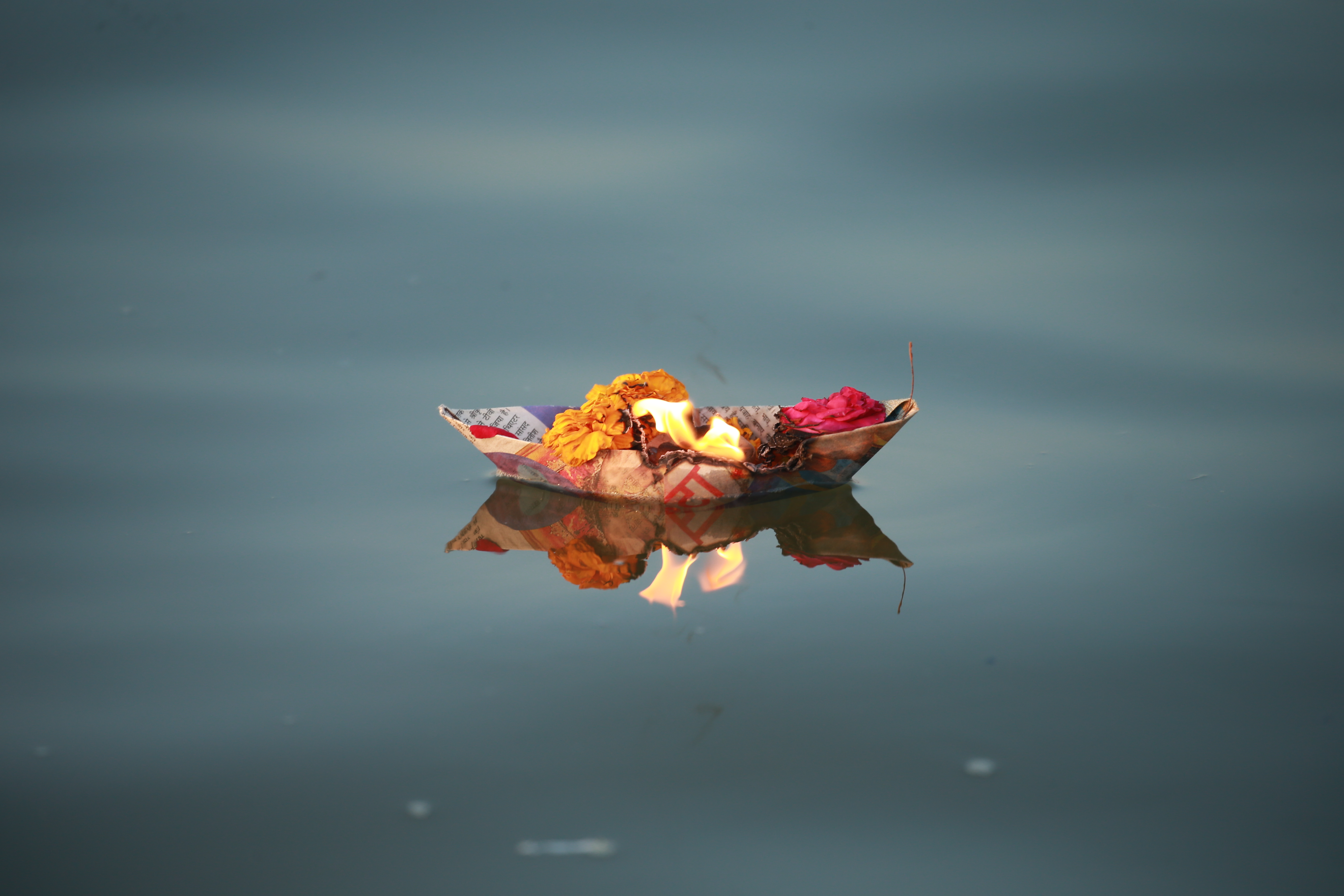 Offerings by Devotees in The River Ganga