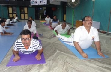 officials performing Yoga