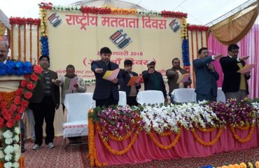 In this image Oath taking by officials at Election Voters Day