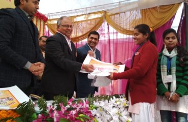 This image shows DM Bahraich distributed certificates to the students