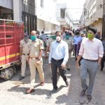 District officials inspecting the district market