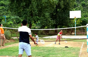 People playing badminton in the court