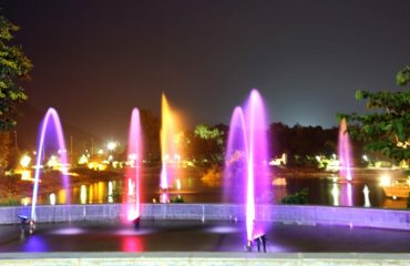 Night view of the colourful fountains glowing in lights