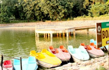Boats lined by on the shores of the lake