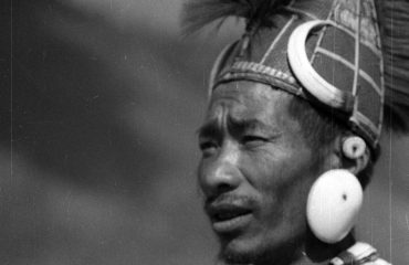 Chang Tribesman in traditional headgear adorned with wild boar tusk and sea shells