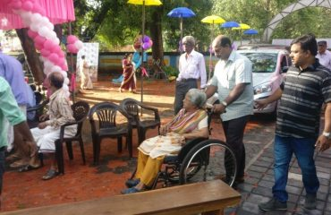Senior citizen is brought for casting her vote-poll day