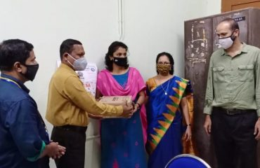 Ambalappuzha Tehsildar giving masks and sanitizers 2020